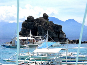 Lunch at Apo Island had this beautiful rock back drop. by Marylin Batt 